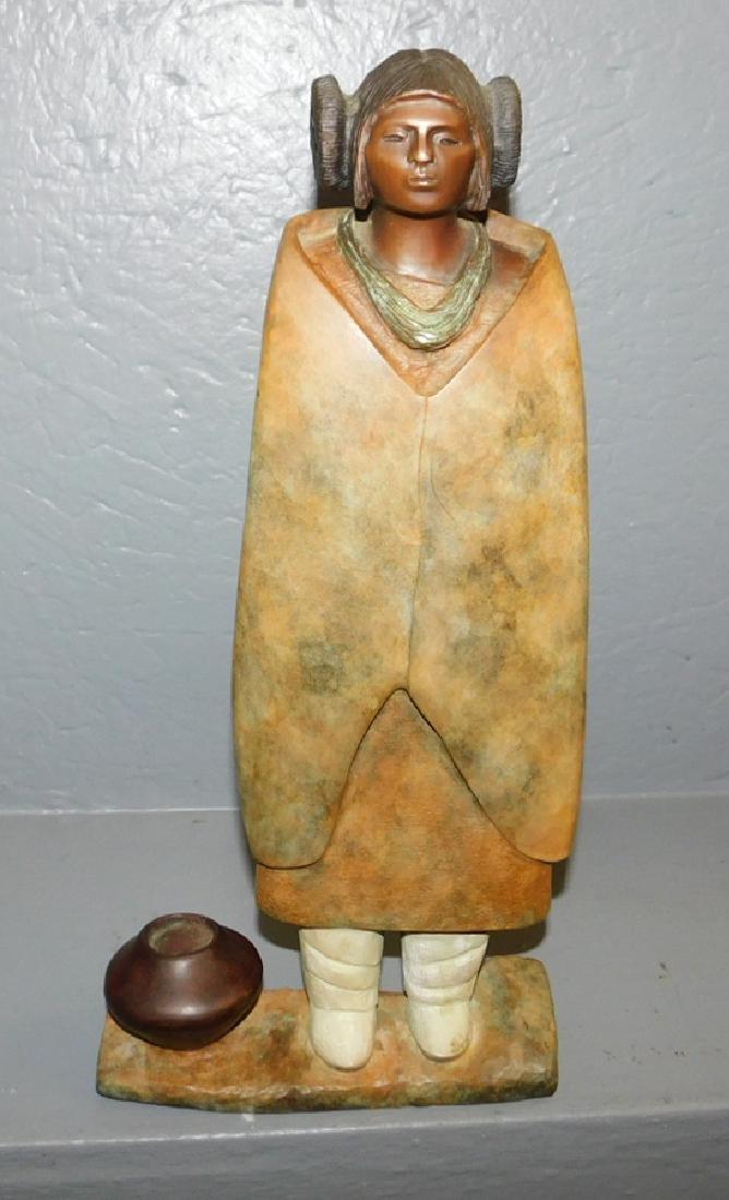 "Bronze Inuit figure. 15"" tall."