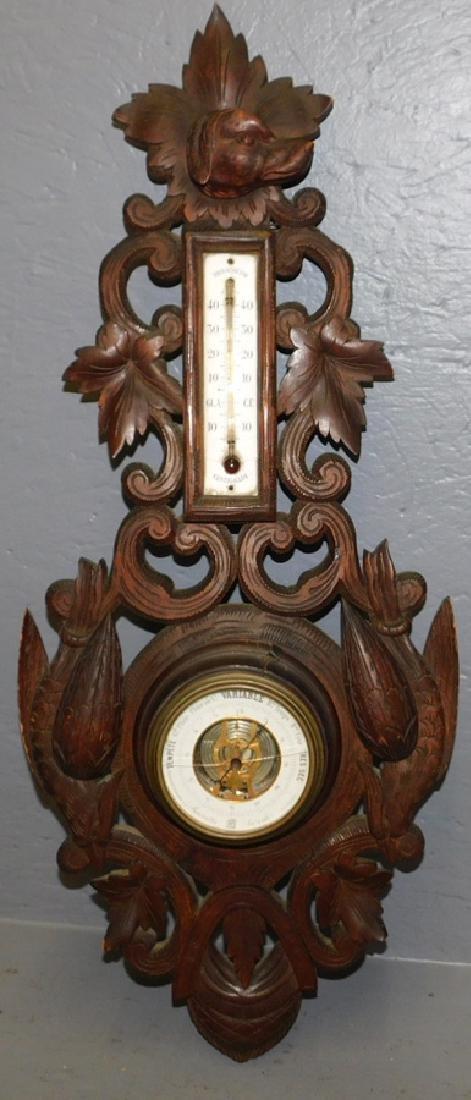"Carved Back Forest Walnut barometer. 29"" tall."