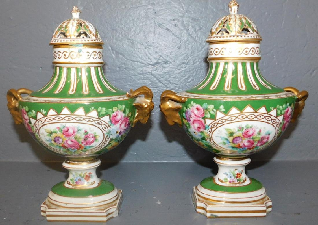Pair of unsigned Sevres rams head urns-