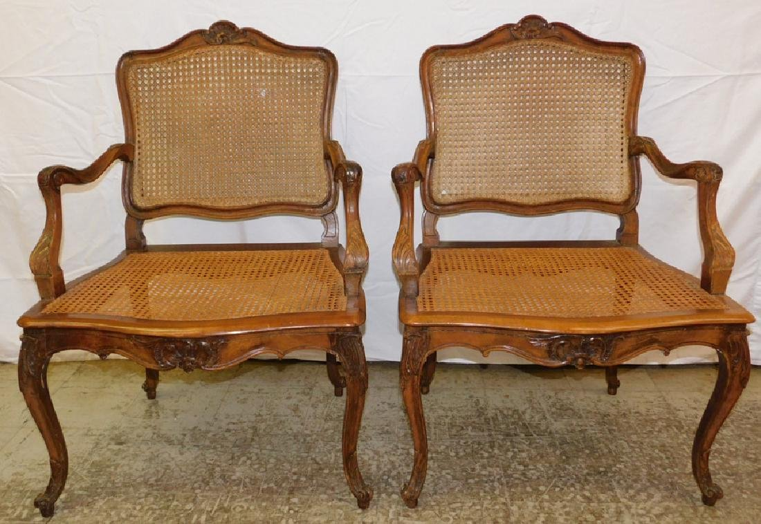 Pair of cane seat and back French arm chairs.