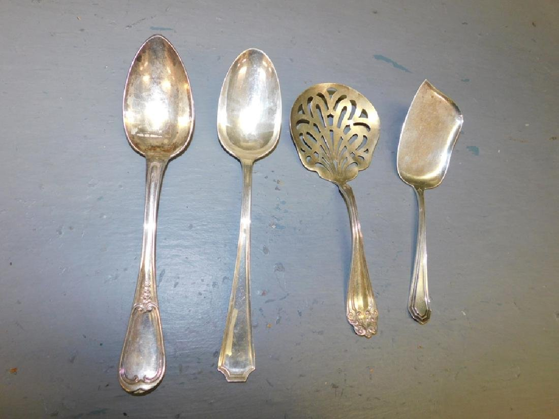 4 sterling serving pieces. 7.75 t.o.