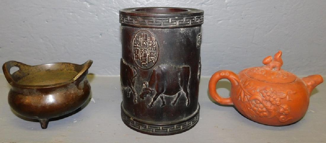 Oriental vase, bronze pot and terra cotta tea pot.