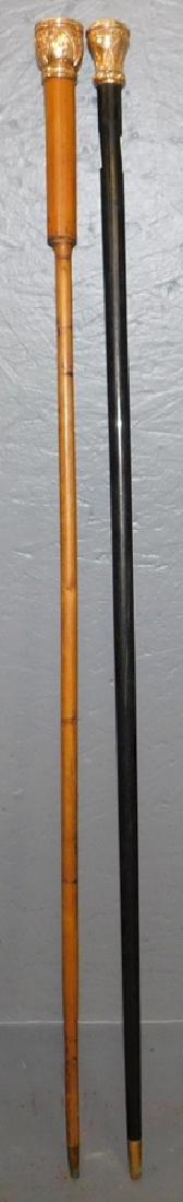 2 Victorian rose gold tipped walking sticks.