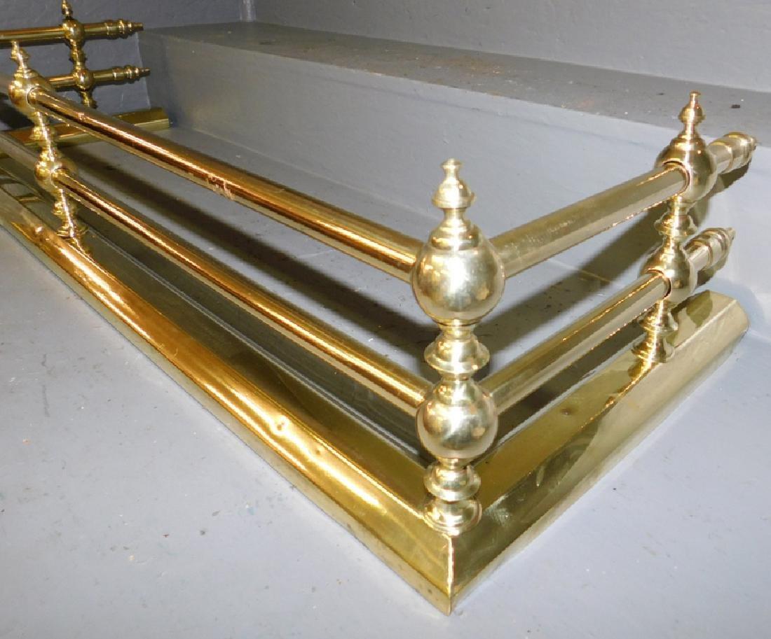 Polished brass tubular fireplace fender. - 2