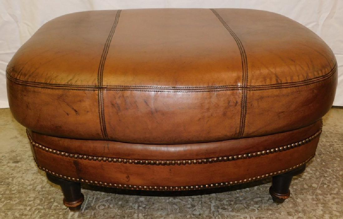 "Leather ottoman. 31"" x 26"" x 18"" tall."