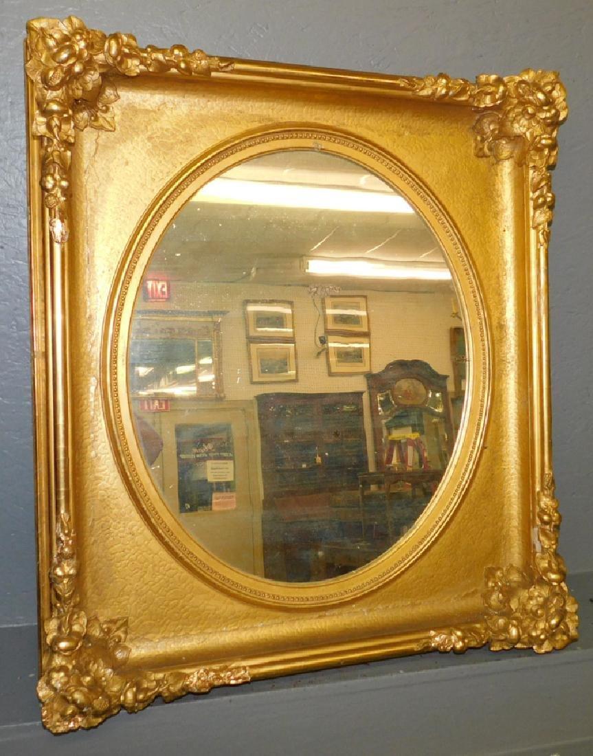 "Gold leaf oval framed mirror. 28 1/2"" x 32""."