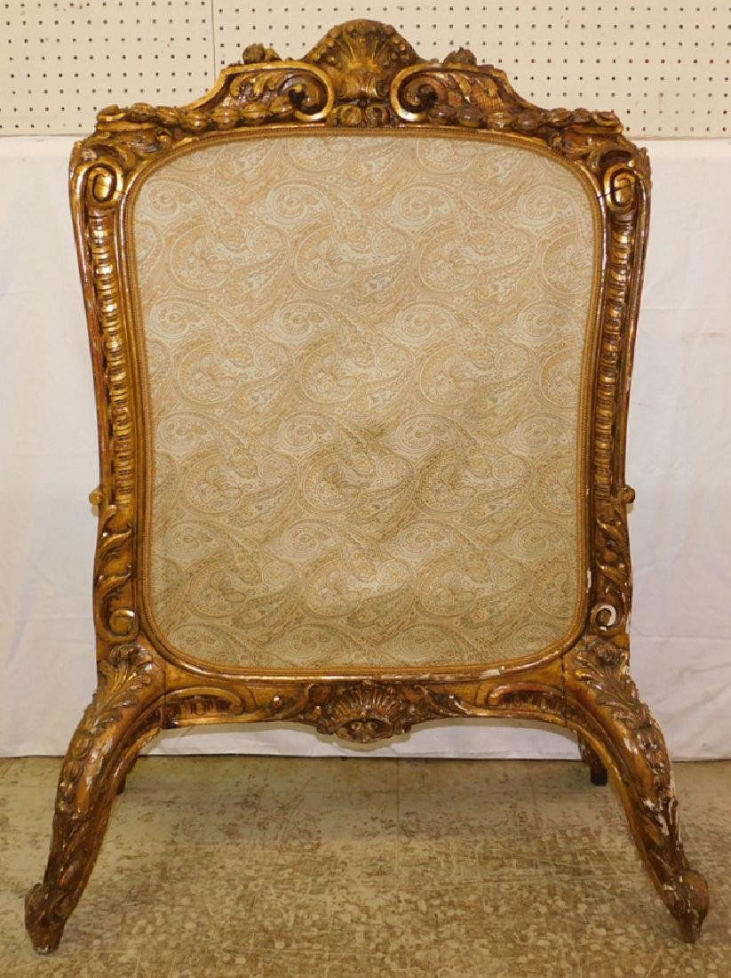 Carved Rococo style fire screen.