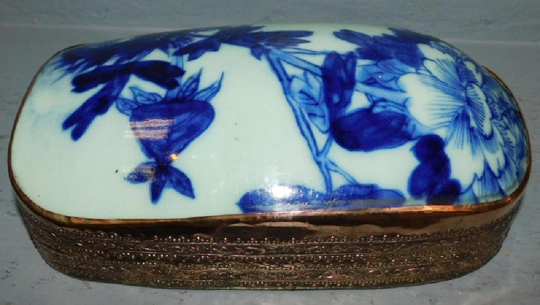 Early copper box w/flow blue porcelain top.