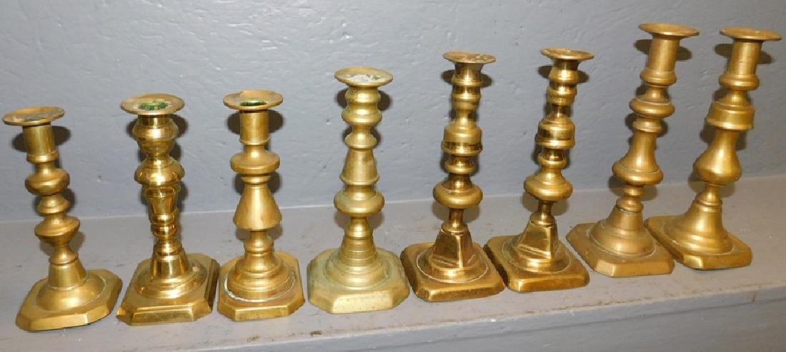 8 19th century brass candlesticks.