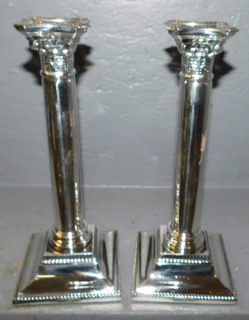 Pr. Silver plated hallmarked Sheffield candlesticks.