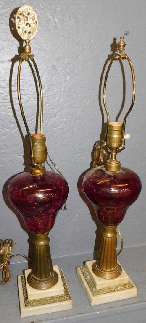 Pr. Cranberry and brass electric oil lamps