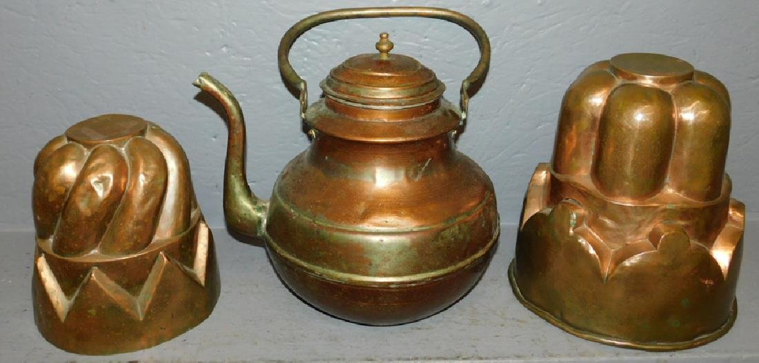 "2 copper molds and copper tea pot. To 9"" tall."