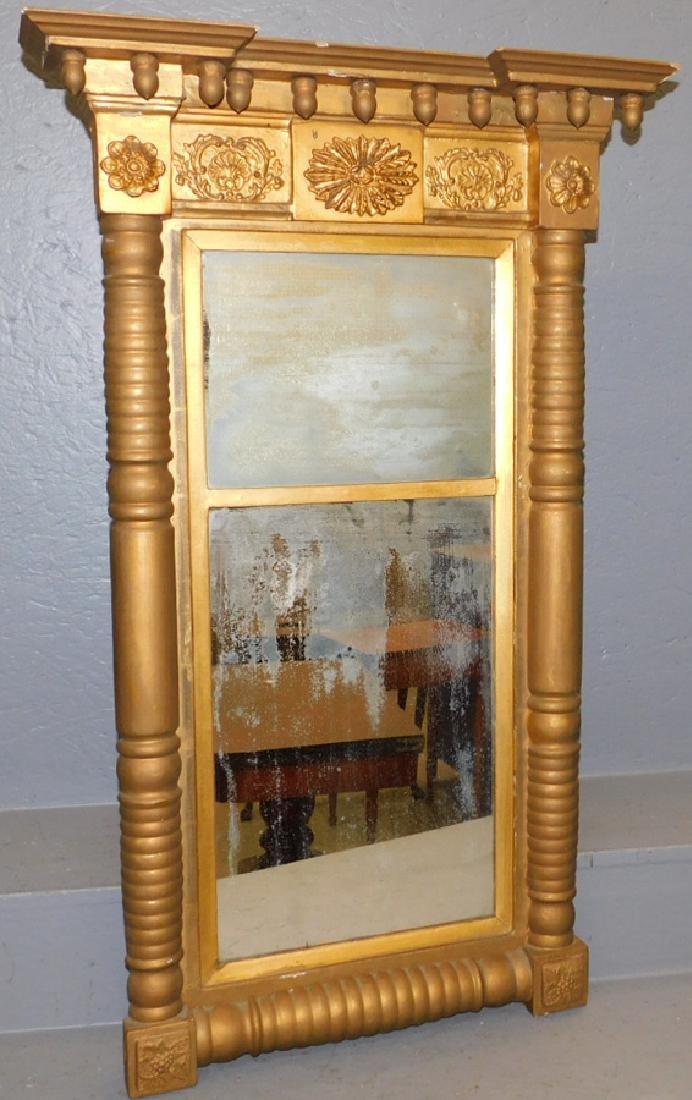 "Early Adams 2 part gold leaf mirror. 40"" x 32"" tall."