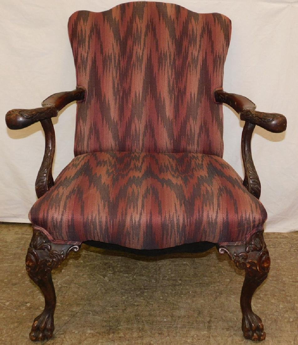 Carved QA mahogany ball and claw foot arm chair.