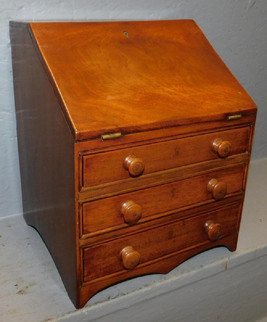 Miniature mahogany slant front desk.