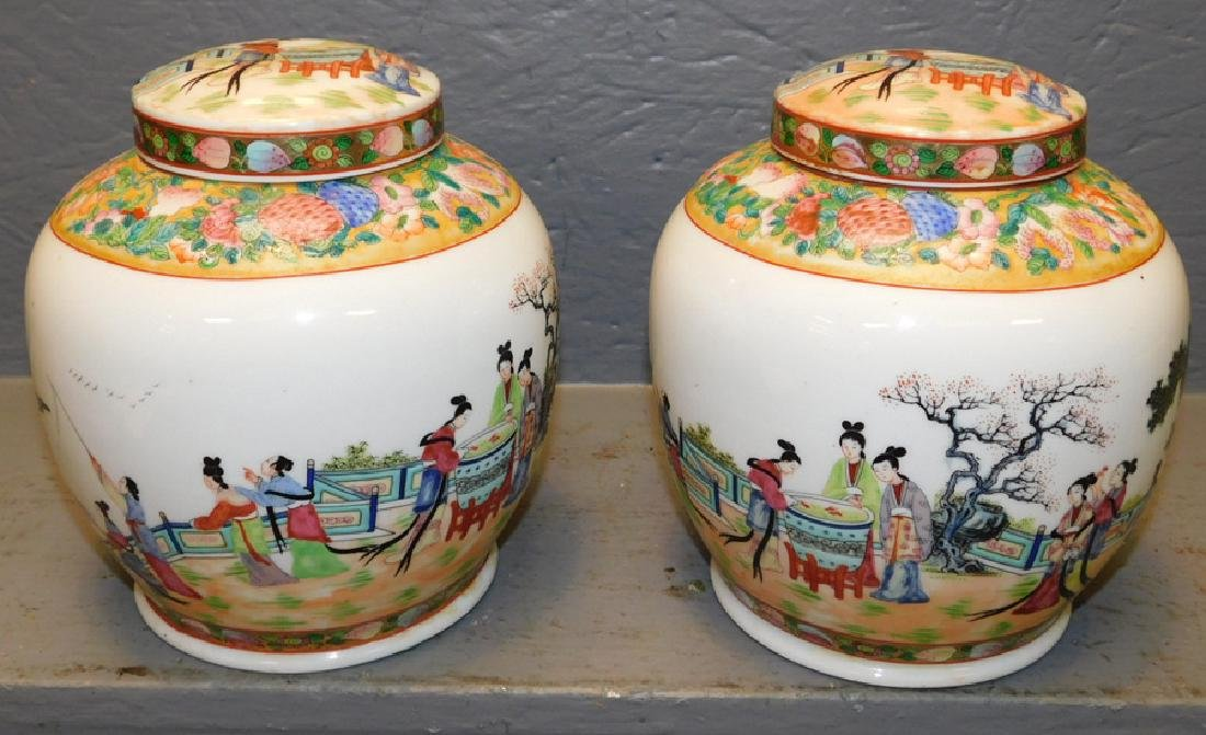 "Pair of Oriental ginger jars. 8"" tall."