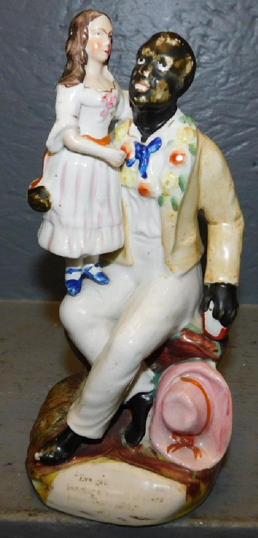 """Rare """"Uncle Tom"""" Staffordshire figure. 8"""" tall."""