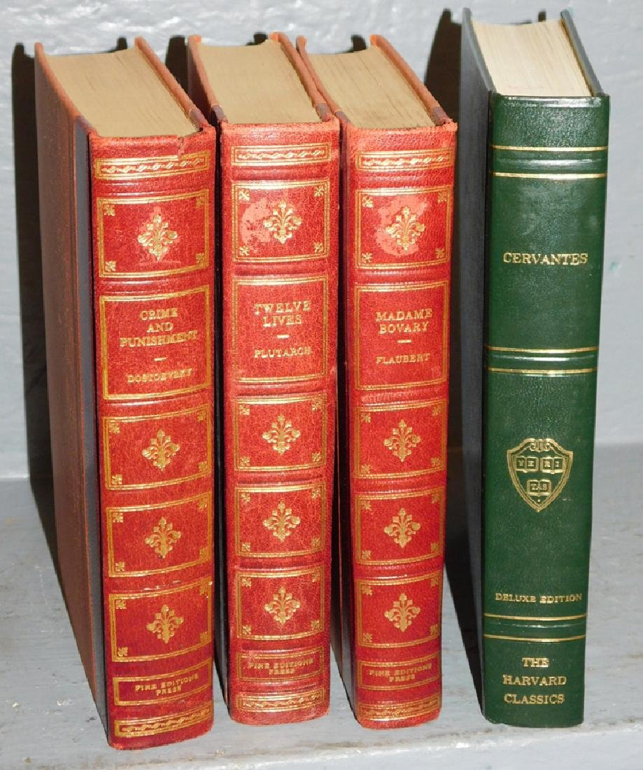 4 quarter leather bound books.