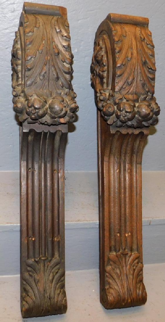 "Pair of oak hand carvings. 25"" long."
