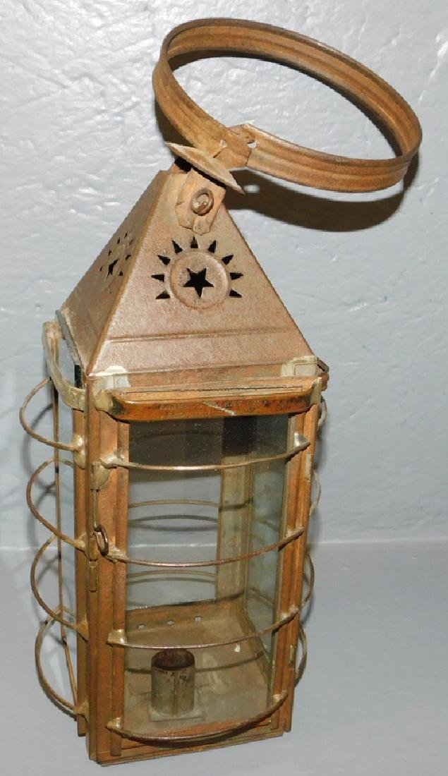 "19th century tole and glass tin lantern. 16"" tall."