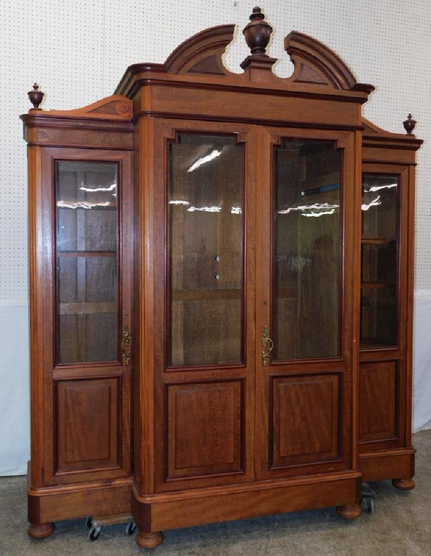 Victorian walnut broken arch top bookcase.