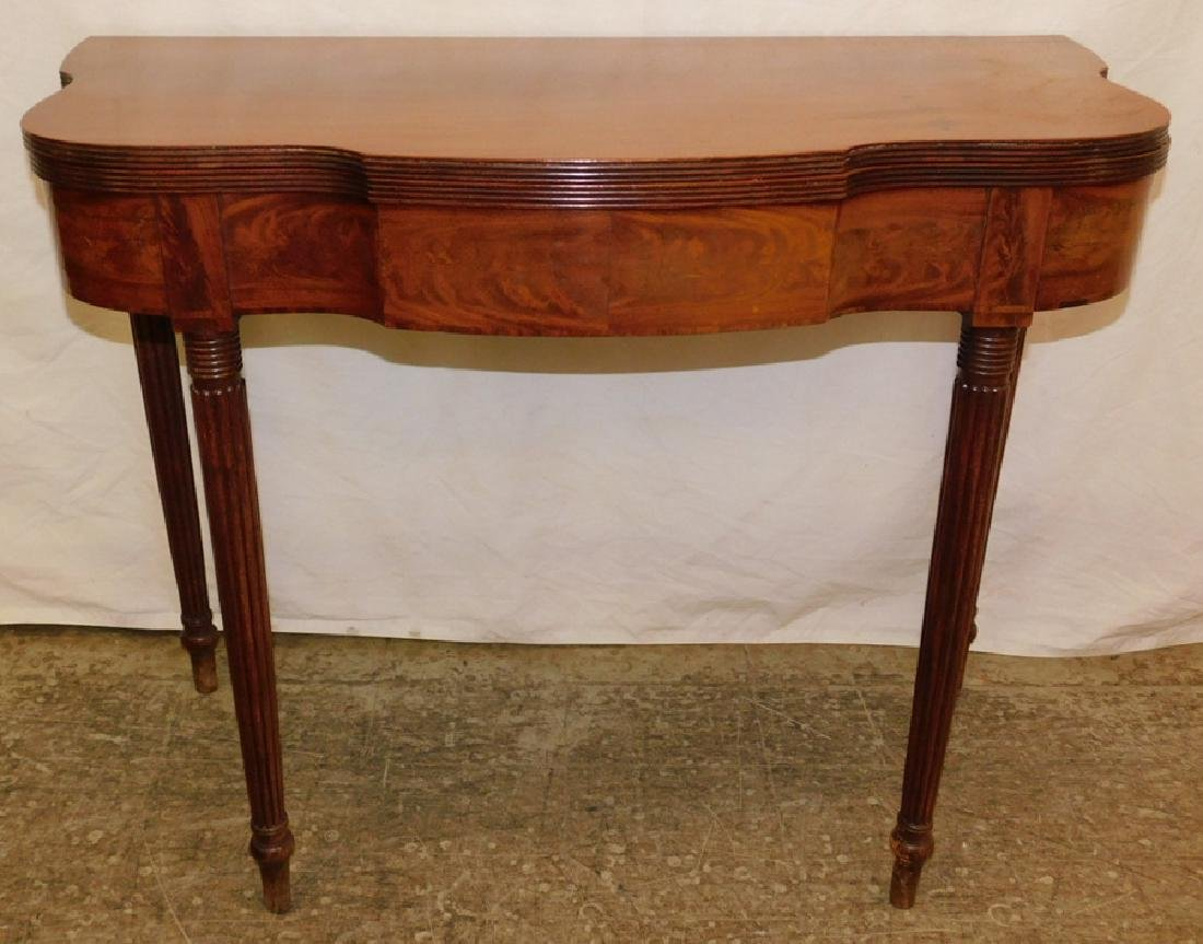 Mahogany serp front Sheraton fold over game table