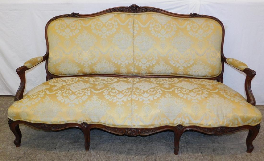 Carved back walnut sofa w/ yellow damask uph