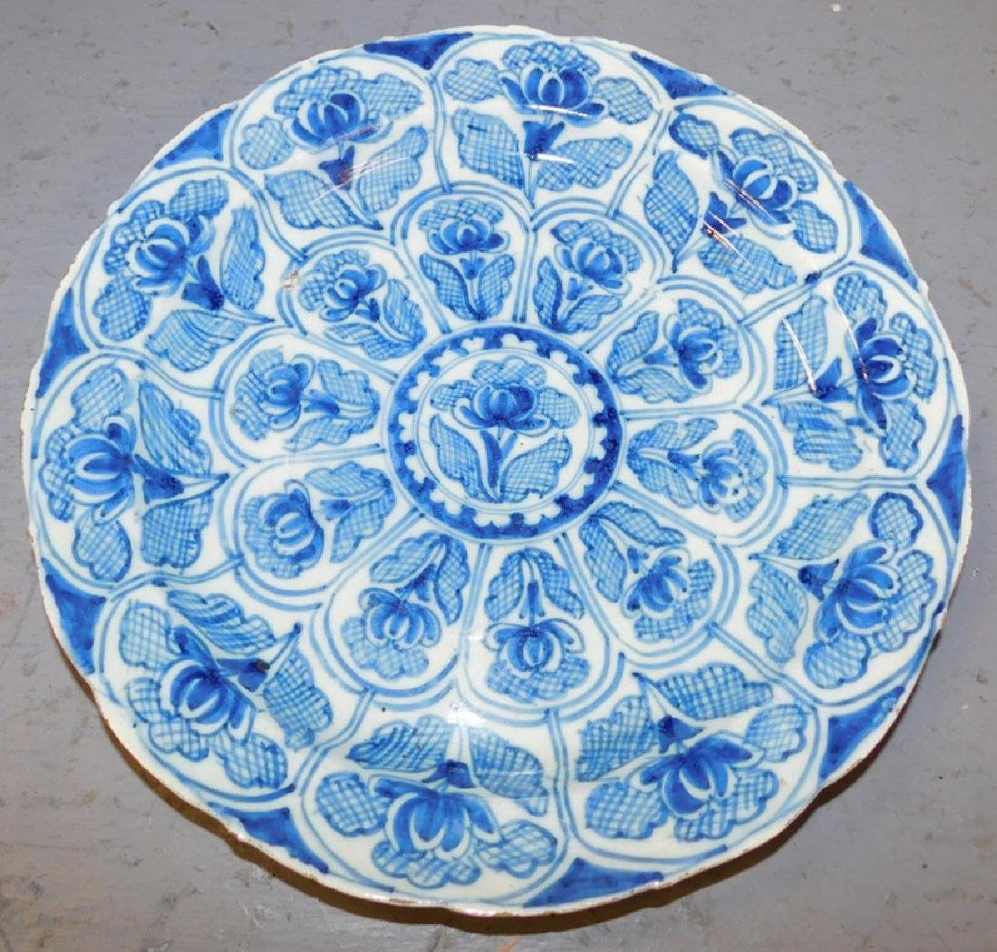 "18th century blue and white Delft plate. 10"" dia."