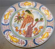 Large Polychrome signed Charger with bird detail.