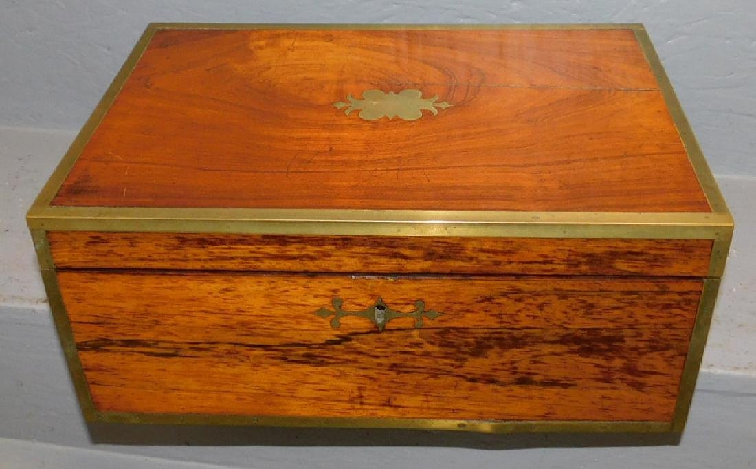 Rose wood brass bound lap desk.