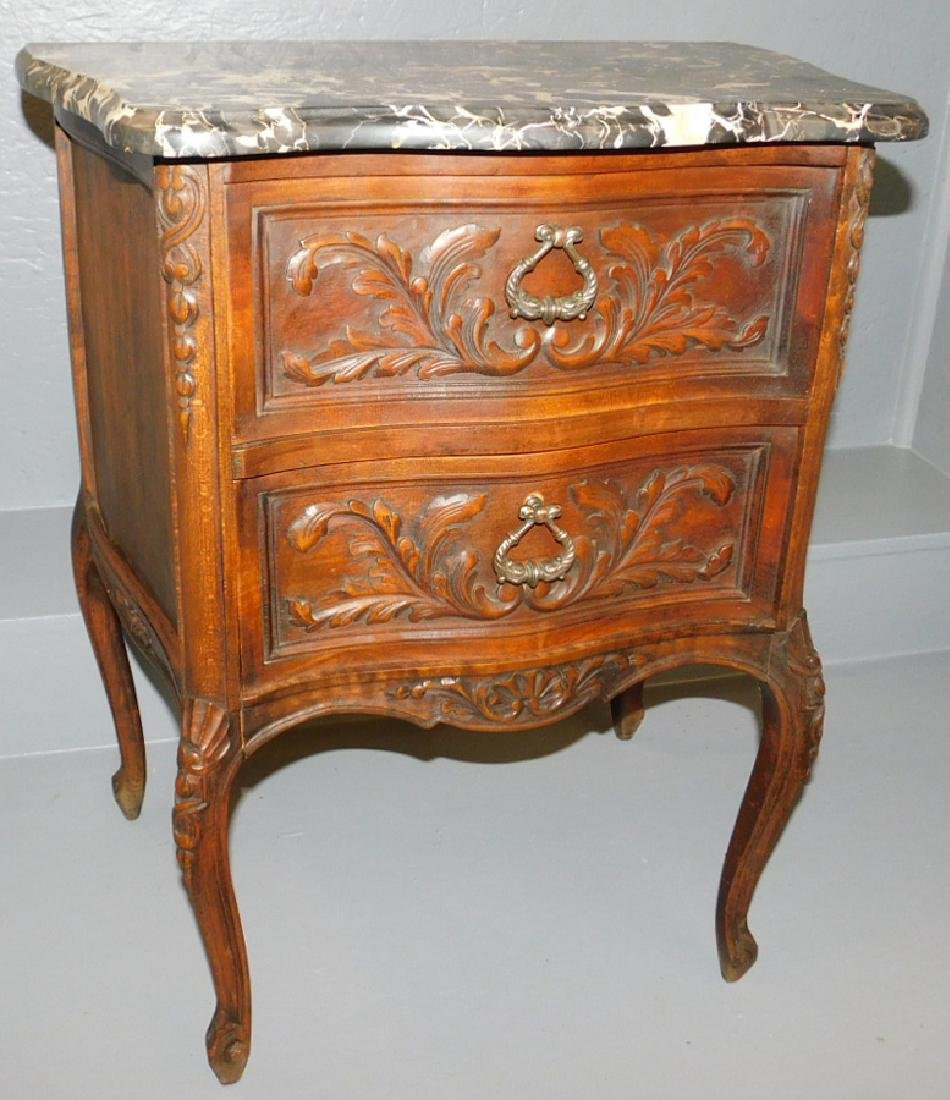 Marble top walnut 2 drawer carved commode.
