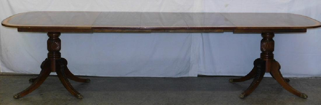 2 pedestal mahogany banded top table w 3 leaves.