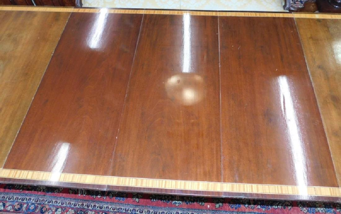 2 pedestal mahogany banded top table w 3 leaves. - 4