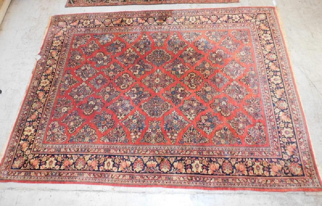 "13'4' x 9'9"" antique Sarouk rug (as is)."