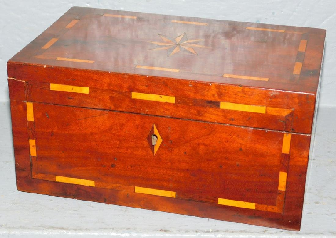 Pinwheel inlay tea caddy with fitted compartments.