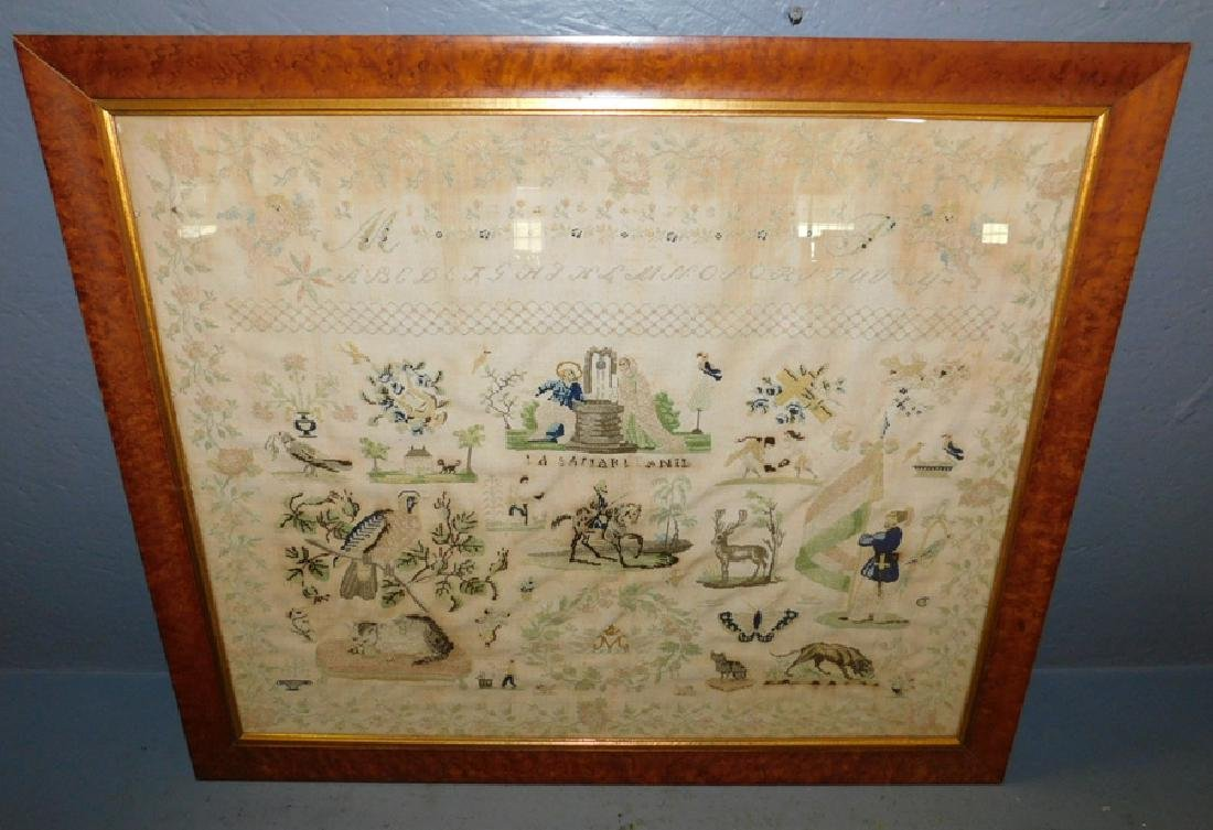 Sampler in birds eye maple frame. Fading, not legible.