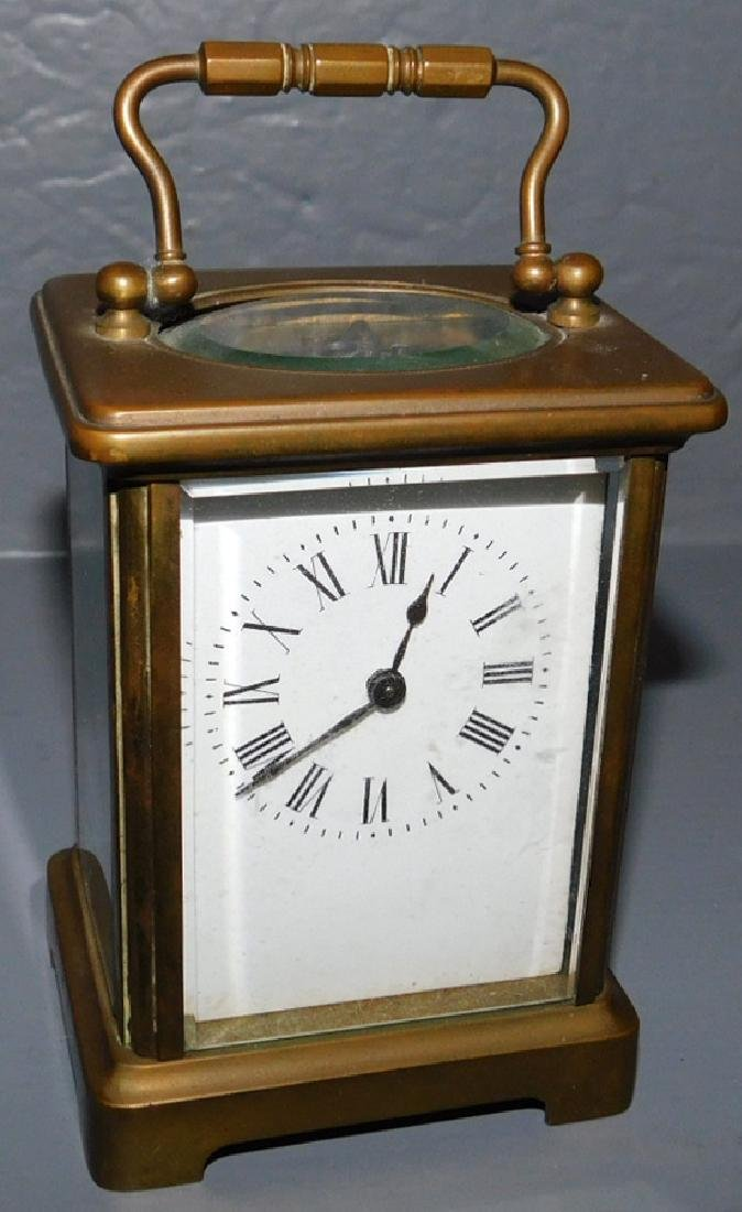 "Brass and bevel glass carriage clock. 5"" tall."