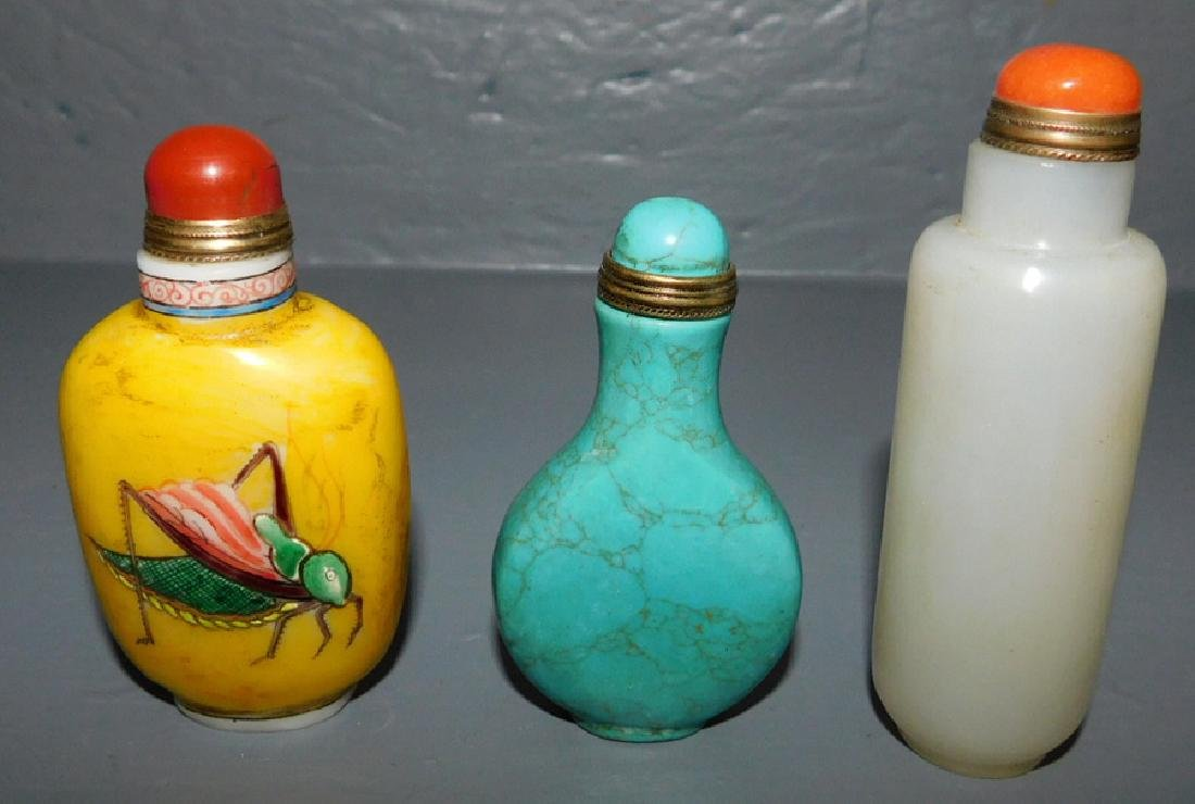3 carved Or snuff bottles. One has cricket motif.