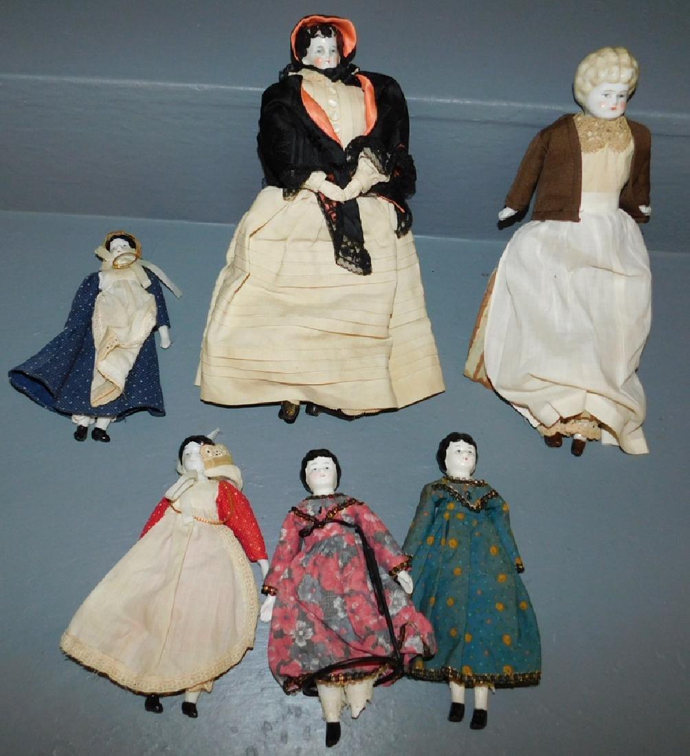 """6 miniature porcelain dolls. To 13"""" long."""