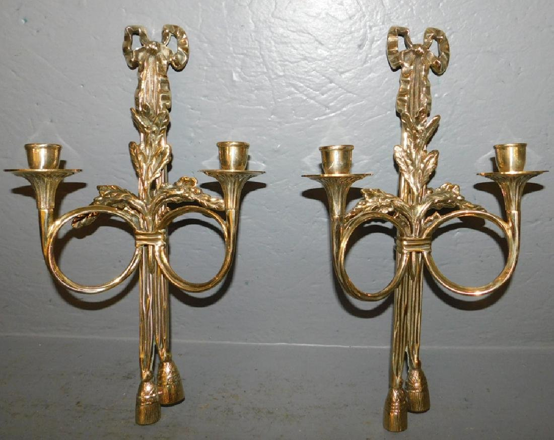 "Pair of polished brass 2 light sconces. 17"" tall."