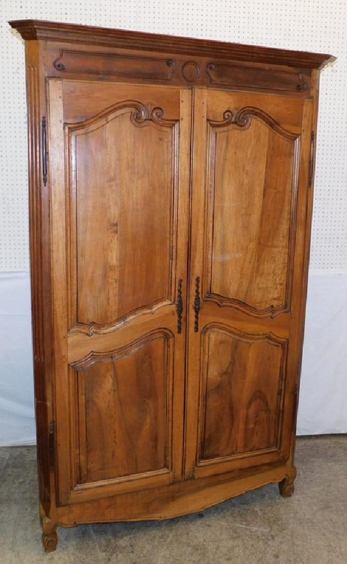 18th century carved French walnut corner cupboard.