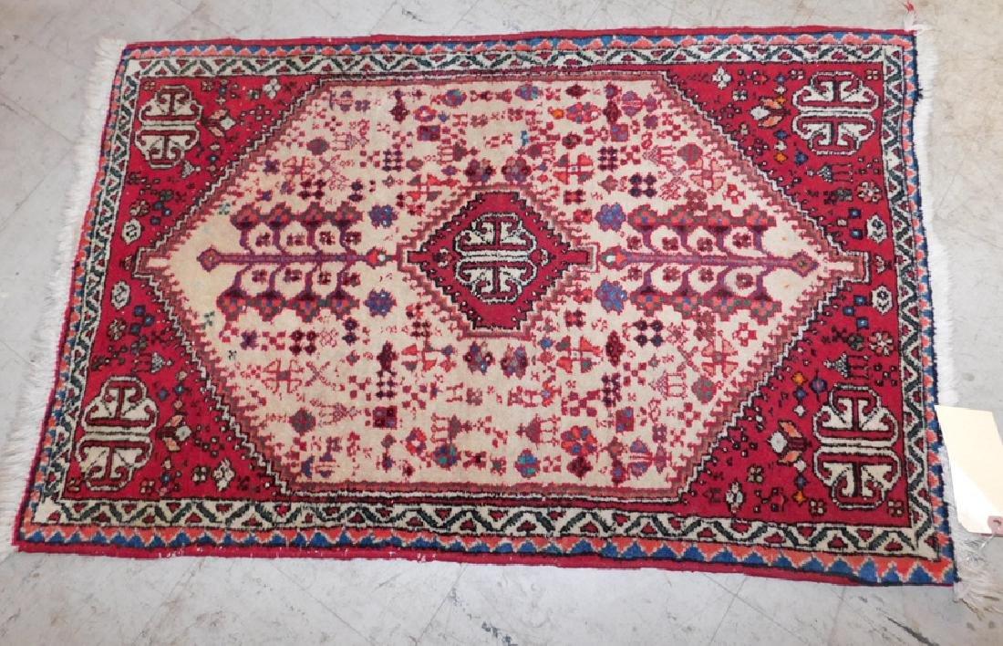 """2' x3""""3"""" handmade scatter rug."""