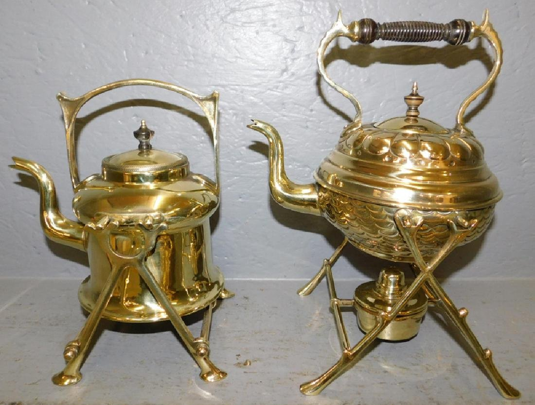 """2 early polished brass kettles on stands. To 12"""" tall."""