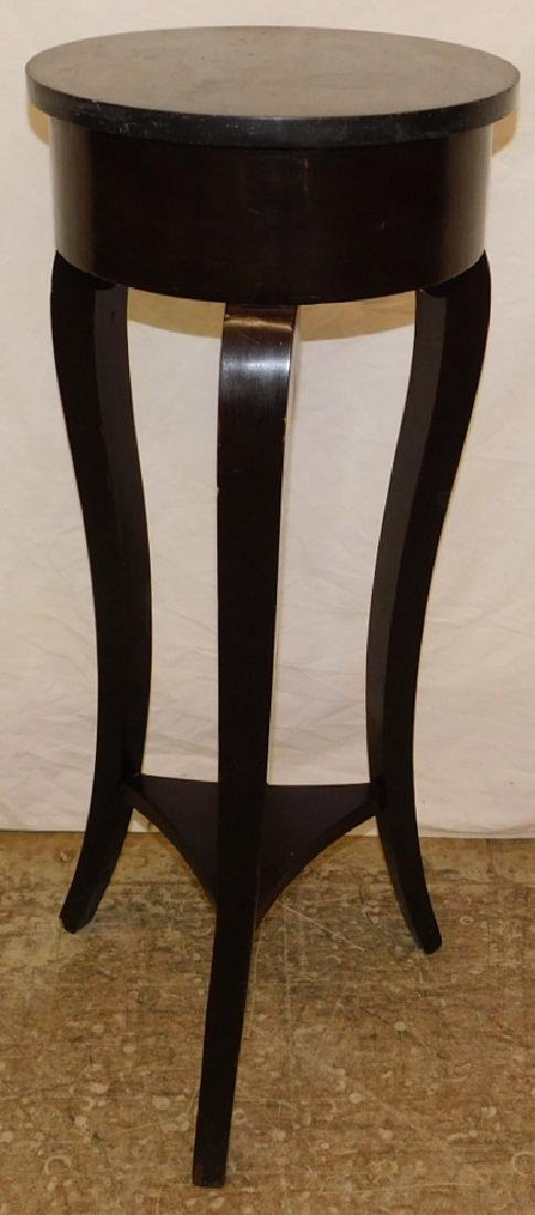 Round black marble top candle stand.