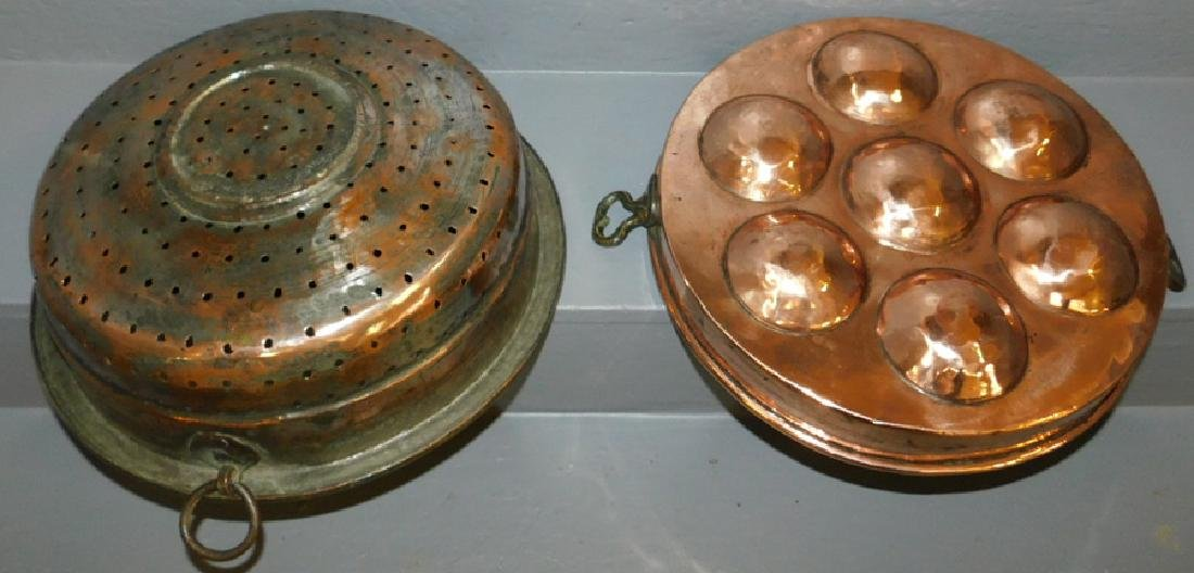 Polished copper strainer and egg poacher. - 2