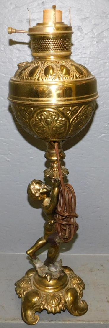 Brass cherub base American Victorian lamp.
