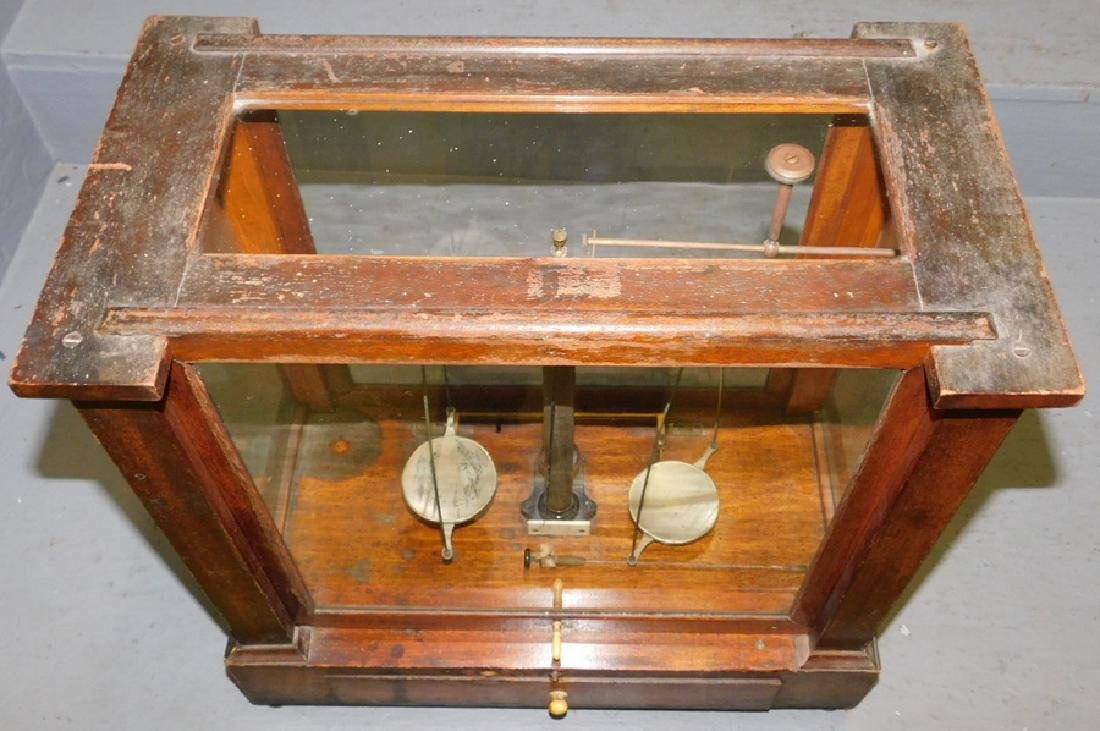 Pair of  brass scales in glass case. - 2