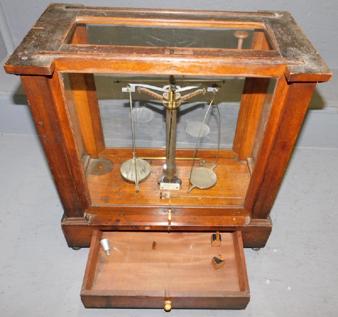 Pair of  brass scales in glass case. - 3