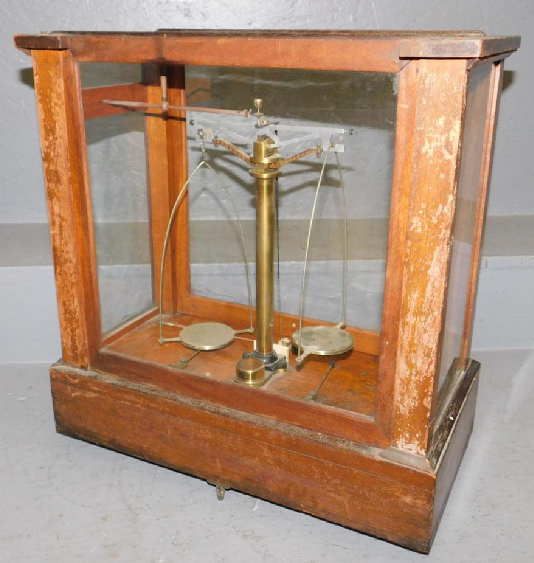 Pair of  brass scales in glass case. - 4
