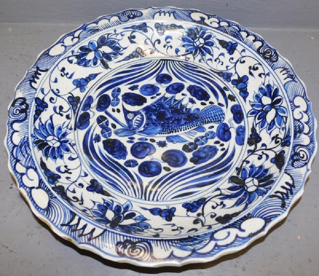 Dark blue and white Oriental low bowl.